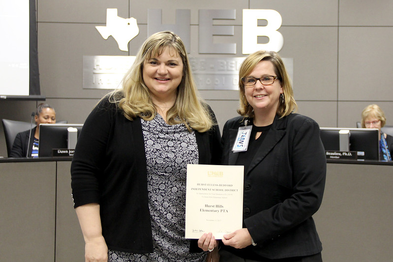 Board Member Julie Cole with the principal of Hurst Hills Elementary, recognizing a donation from Hurst Hills Elementary PTA.