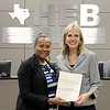 Board Member Dawn Jordan-Wells with an assistant principal of Central Junior High, recognizing a donation from Brident Dental / Western Dental Services, Inc.