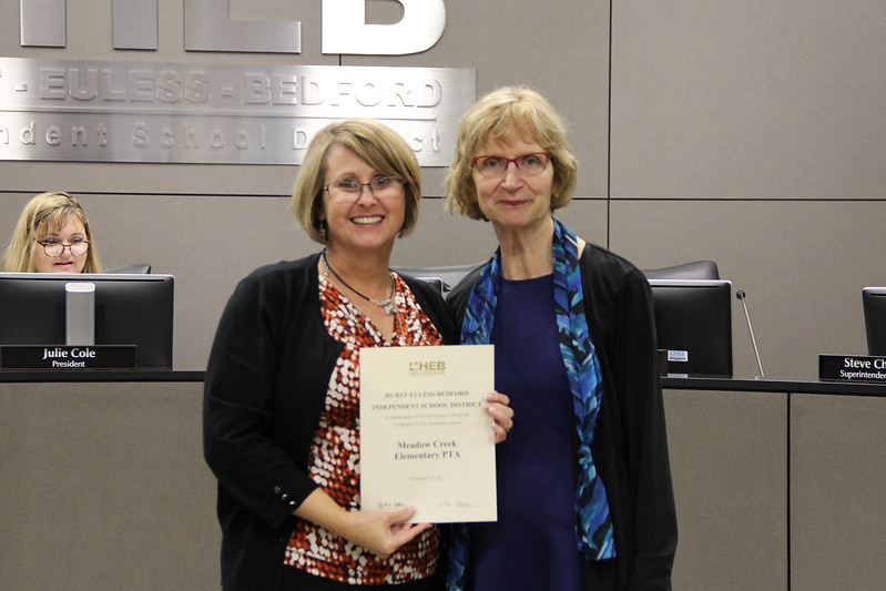 Board Member Faye Beaulieu with the Assistant Superintendent of Elementary Administration, recognizing a donation from Meadow Creek Elementary PTA.