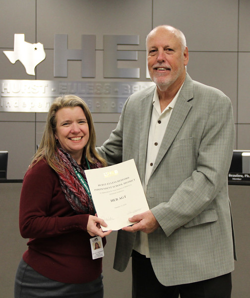 Director of curriculum Holly Noorgard and board member Andy Cargile in recognition of a donation from HEB AGT.