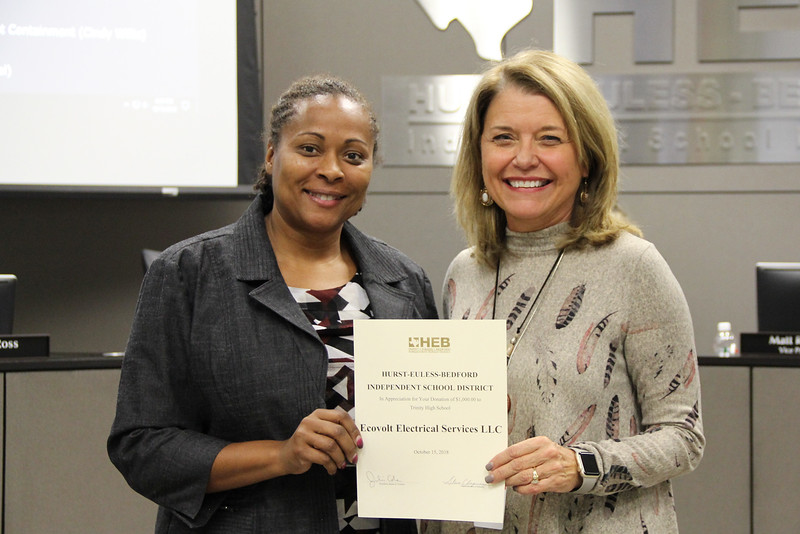 Board member Dawn Jordan-Wells with Trinity High School assistant principal Becky Ewart in recognition of a donation from Ecovolt Electrical Services LLC.
