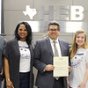 Fred Campos with representatives from Bellaire Elementary, with a certificate in honor of a donation from the Bellaire PTA and Bell Helicopter.