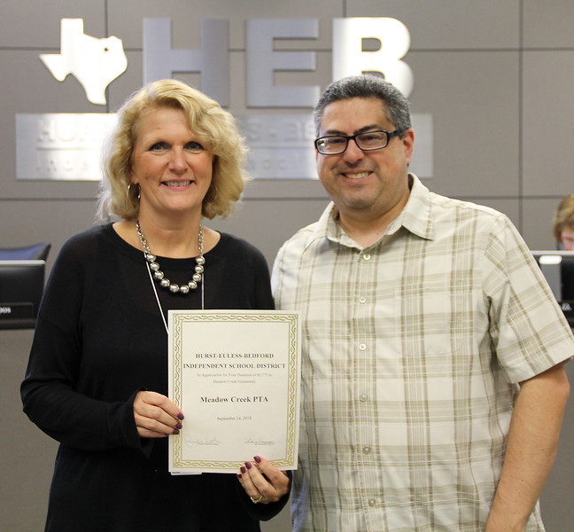 Board member Fred Campos with Meadow Creek Elementary principal Doreen Mengwasser in recognition of a donation from the Meadow Creek PTA