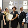 Board member Dawn Jordan-Wells with representatives from Bellaire Elementary and Bell Helicopter, in recognition of a donation from Bell