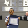 Timothy Cherry holding his certificate for leading the pledge of allegiance.