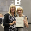 Lakewood Elementary principal Julie McAvoy with Board Member Faye Beaulieu  in recognition of a donation from the Bivens family.