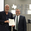 L.D. Bell High School principal Jim Bannister receiving a donation certificate from Board Member Andy Cargile