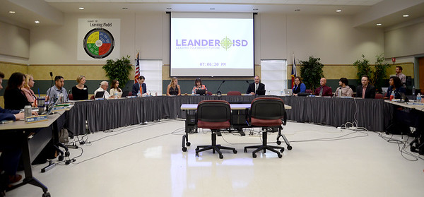 Student leaders from the district's six high schools sit at the dias with the Leander ISD Board of Trustees at the May 17 meeting.