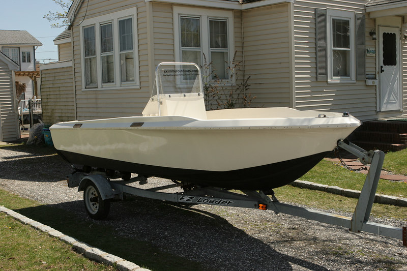 4/17/2006<br /> <br /> With the bottom all painted and the console in place I am all ready to bring her down to Burnett's. Not to bad looking for a 25 year old boat. The only thing I need to do now is install a new rub rail. The old rub rail shrank over a foot since last September when I took it off.