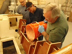 We are pouring the mix through the trough that George made. It worked out just fine. We used long sticks to poke the material deep into the transom. We then used an air hammer to vibrate the transom to remove any air spaces and settle the material all the way to the bottom.
