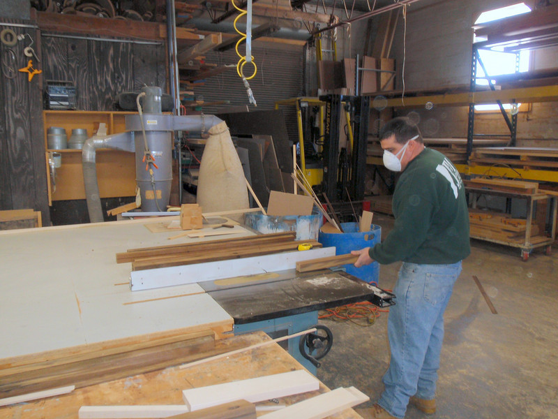 Here is Pete cutting groves into the pieces that will fill the underside of the pulpit where it is thickest.