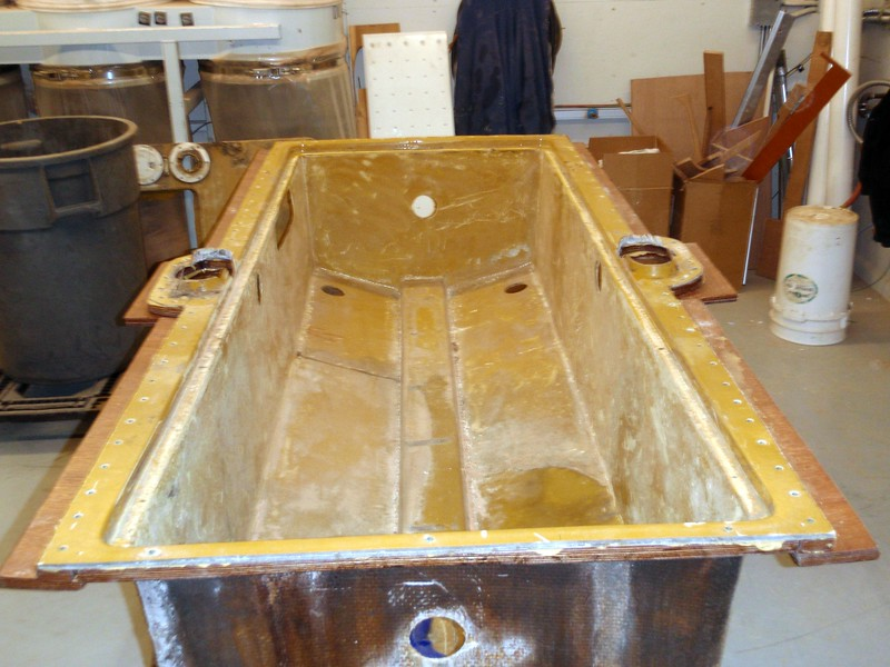 Here sits the gas tank coffin all built up with cleats in place to match up with cleats on the outer deck surface.