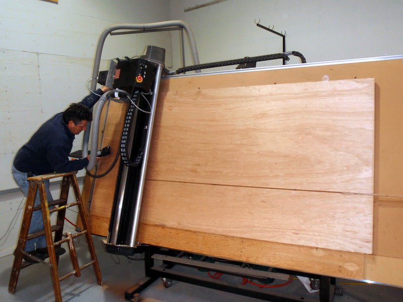 George is setting up the router to cut the wood to exact dimensions for the coffin plug. The wood weighs in at under what the original fiberglass cover weighed but with a fiberglass under liner and top coat it will be about the same but clean and very solid.