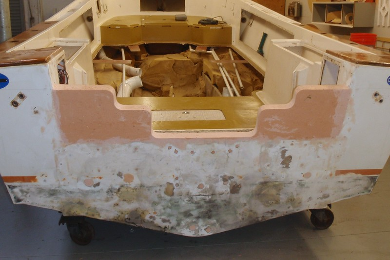 The Seacast Transom job turned out better than expected. Here is the result. The entire transom is now filled with resin and fiberglass and the outboard sides were raised to reduce water splash into the well.