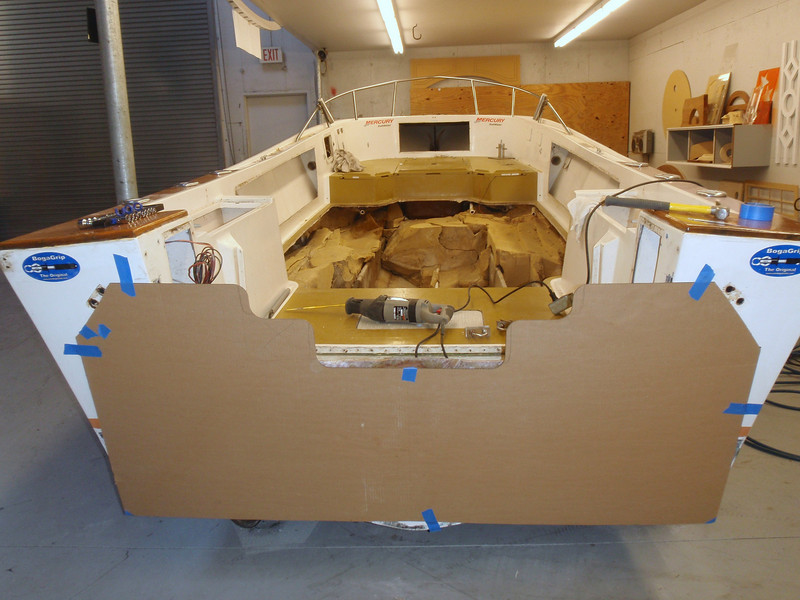 George cut a template for the new transom configuration using his laser on cardboard. I am keeping the 25 inch height but raising the rest of the transom cut to prevent water flooding the transom well when getting hit by seas from the stern and to give greater overall strength.