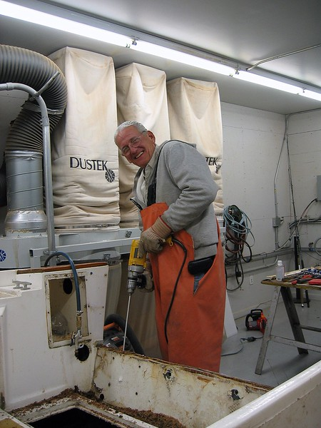 drilling out transom with 12 inch by 3/4 wood boring bit and adding a 12 inch extension to reach to bottom of transom.