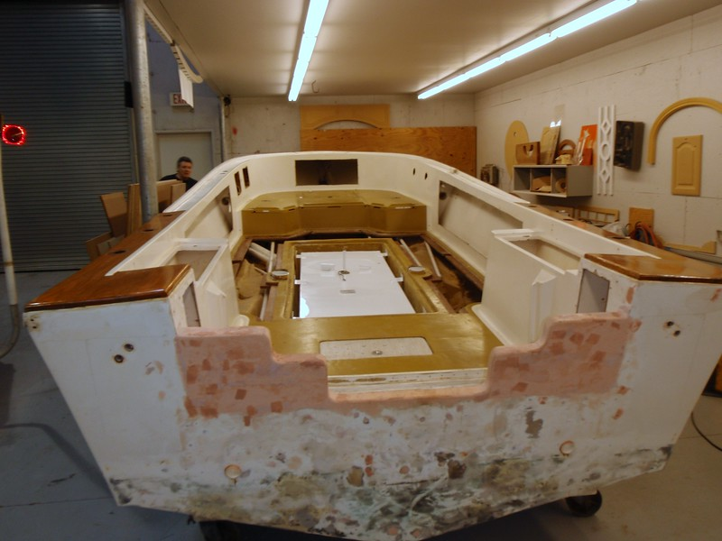 Things are looking good. We just need to foam the remaining open areas and lock in the tank with foam. We can then lay down the deck and fiberglass it all to seal the deck area.