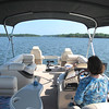 Connie driving the boat.  We've got lots of room for passengers.  Everybody we asked was too busy to go out this time.