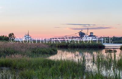 The 'Michipicoten' at sunset passing by Neebish Island