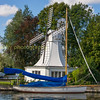 Sailing boat moored by Horning windmill on the norfolk broads