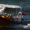 Aberystwyth inshore lifeboat crew return to base after an exercise.