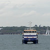 A Hythe ferry tied up at Calshot,  photographed from Calshott castle