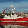 red fishing vessel berthed at Fraserburgh