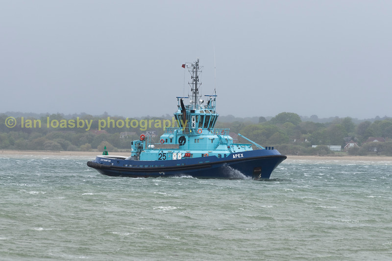 Southampron Tug Apex makes her way out to open water passing Calshot