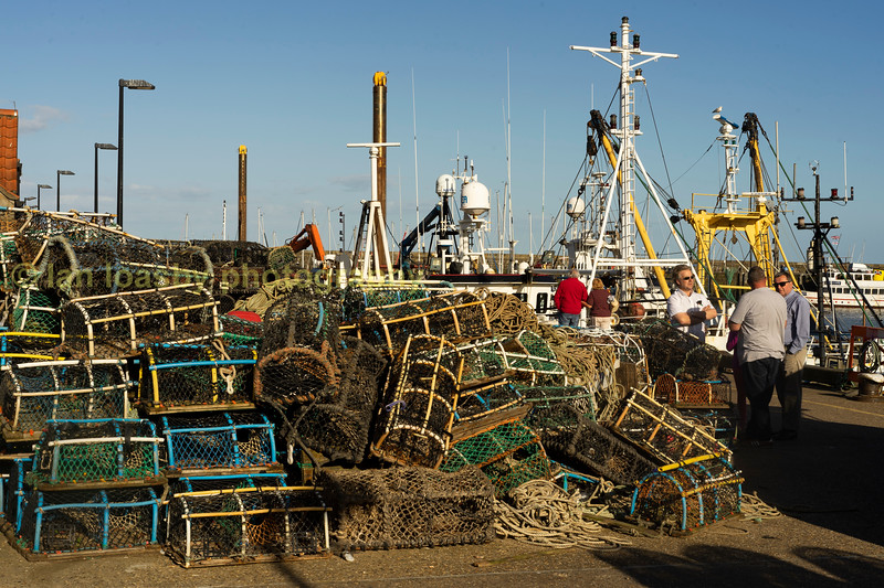 Lobster pots,and discussions on the quayside