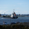 MV Whitchampion eases her way into poole harbour passed the studland -Sandbanks car ferry