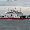 One of th many frequent red funnel ferries that run between Sothampton and Cowes on the Isle of Wright passes Calshot