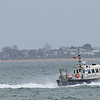 Southampton pilot boat follows a ship out of southampton water in what was to become a extremly windy day