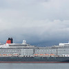 Now safely turned through 180'' and facing down the Solent Queen Elizabeth starts to make her way sedately down Southampton water and out to sea
