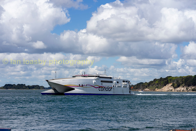 Condor rapide a fast ship capable of 48kts ( 89kph - 55mph) currently employed on the poole-chanel islands -St.Malo route and seen here at Sandbanks Poole