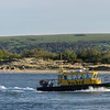 Poole harbour pilot boat makes its way back into Pole harbour in gorgeous evening sunshine