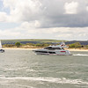 Sea going cruiser sets off out of Poole harbour and into studland bay
