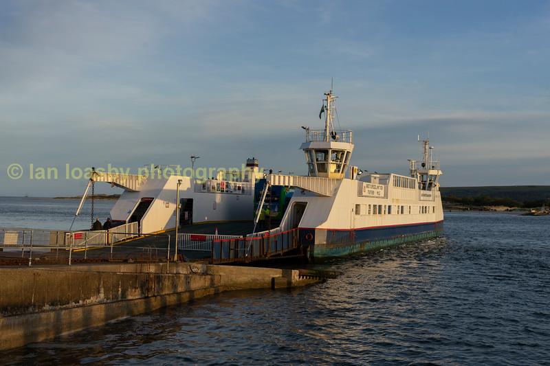 The Sandbanks -Studland ferry bathed in golden evening sun