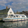 Modern norfolk Broads hire boat tied up at Horning