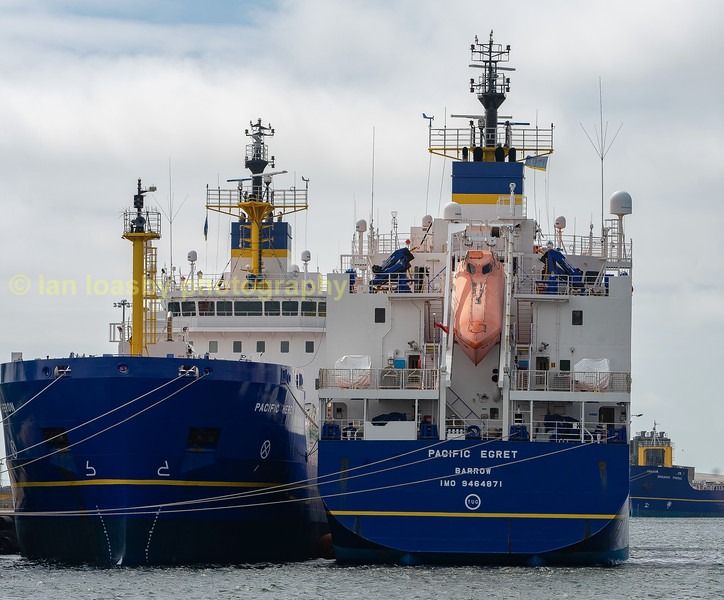 Two of the three most modern ships in the fleet of International nuclear services who operate then for pacific nuclear transport Ltd for the carriage of nuclear waste from japan back to Sellafield for reprocessing. These vessels are photographed at their berths at their NW base