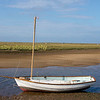 Dinghy tied up  in a creek blakeney norfolk