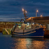 Night time portrait of a fishing boat in macduff harbour Aberdeenshire