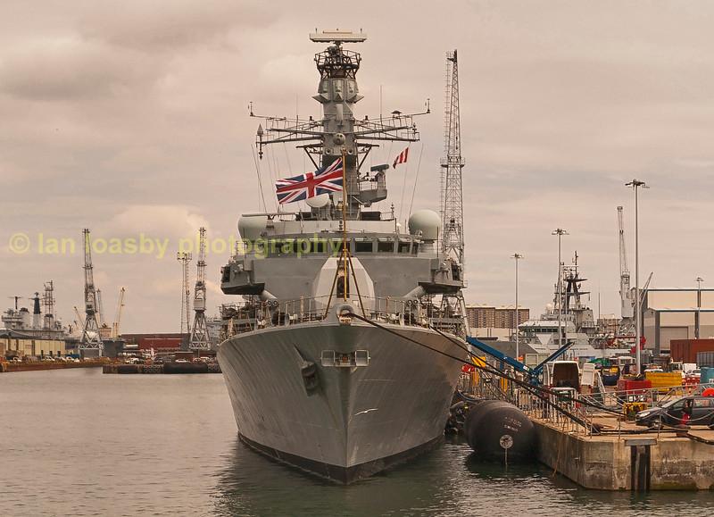 Visiting USN vessel berthed at RN dockyard Portsmouth.