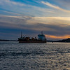 MV Sand Heron a UK flagged , built in 1990 dredger is seen leaving Poole on a gorgeous June 2021 evening harbour at sunset