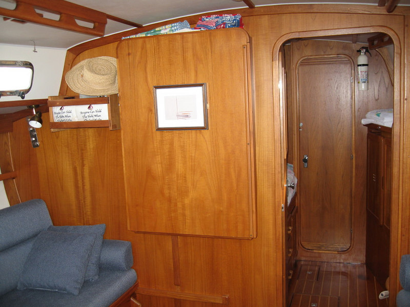 Looking forward into forward stateroom.  Drop-down table to port.