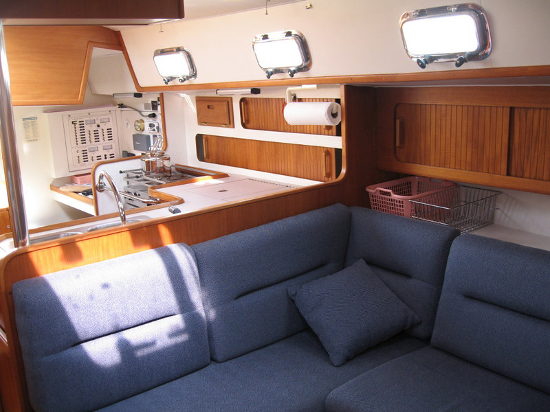 Port side, looking aft, showing nav station, galley and port settee.