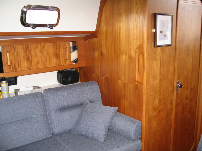 Starboard settee and door to aft head.