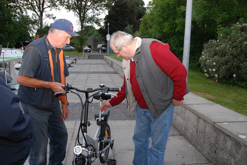 "Brendan ""Trade Winds"" O'Dowd demonstrating his newly acquired battery-powered folding bicycle to Paul ""Arthur"" Scannell at Castle Harbour on Friday, June 13th 2008, prior to the commencemnt of a Cruise in Company to Meelick Quay (Sat), Clonmacnoise (Sun), Athlone (Mon) and return to home ports (Tues/Wed). A total of 9 boats participated, including: ""Rapport"", ""Scappare"", ""Arthur"", ""TnT"", ""Trade Winds"", ""Cruidin"" (formerly ""Norfolk Lady""), ""Miss Eva"", ""Explorer"", ""This Way Up"".  And whilst ""Blue Moon"" did not travel her crew, Chris & Eileen Smith particpated in activities on Friday and Saturday and extended warm hospitality to those boats that made the return journey to Killaloe on Wed morning!<br /> <br /> It was a wonderful cruise-in-company wherein the pleasant and jovial atmosphere that permeated the entire weekend epitomised the very best in this type of cruising.<br /> <br /> Definitely to be repeated!<br /> <br /> Paul J Scannell,<br /> ""Arthur"""