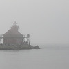 Despite the fog, people lined the pier to see the ships.