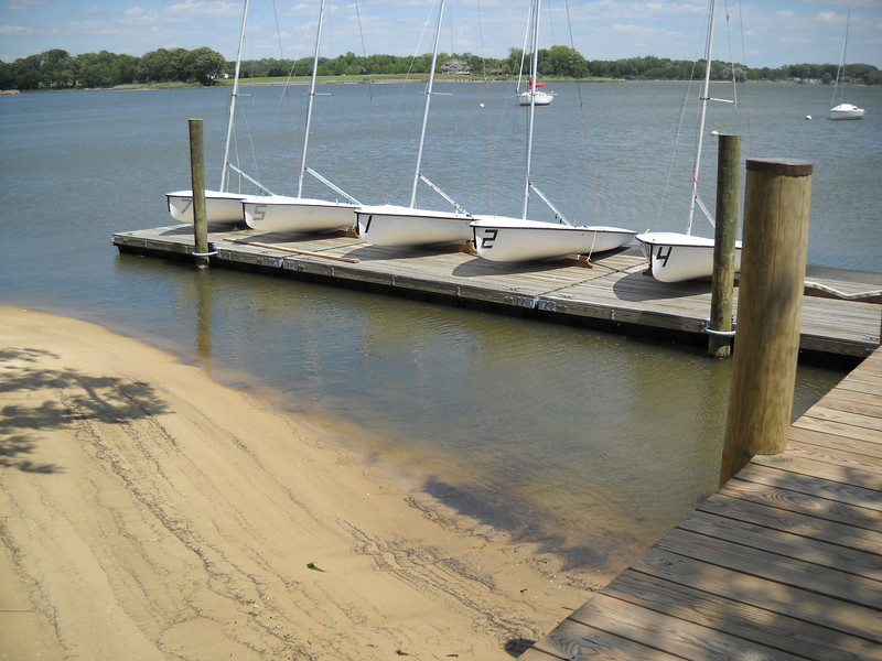 The floating docks with the club's 420's.