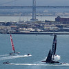 Emirates New Zealand and Oracle Team USA sailing east down the bay in Race 6.